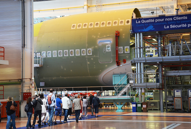 Visitors to the Airbus facility see an A380-AK being built