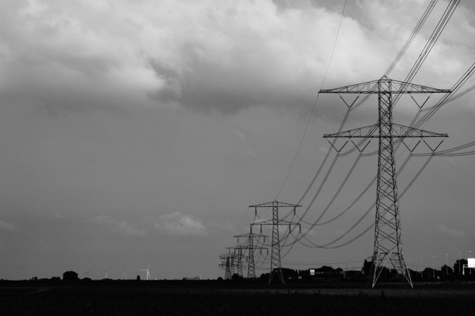 Pylons against a grey sky. Over quarter million homes in major power cut in west France