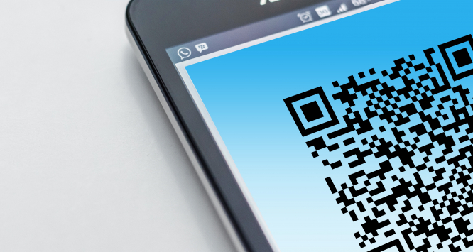 QR code on smartphone. France Covid health pass: What is it and how would it work?