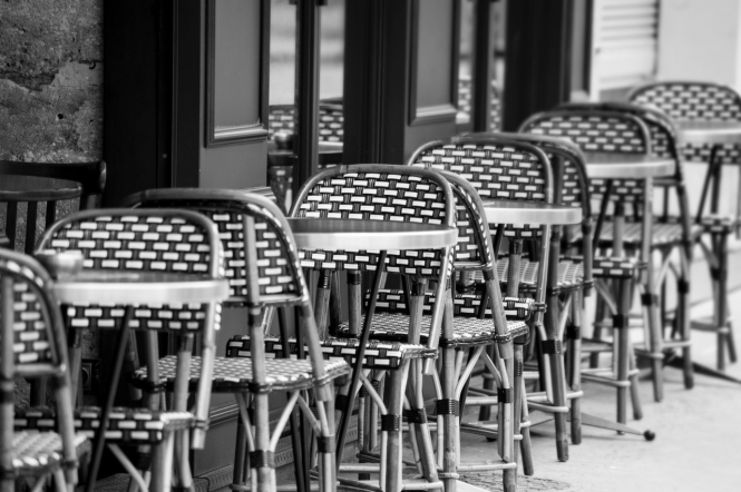 Restaurant chairs empty outside. France: Bars and restaurants may not open before January 15