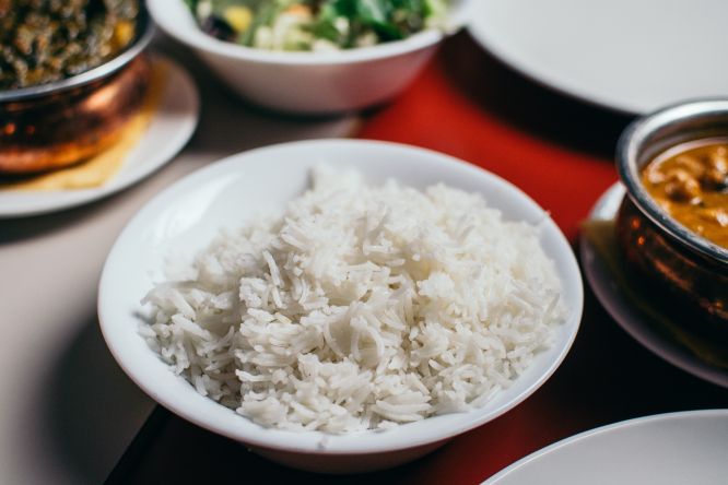 A bowl of white rice. French supermarket recalls basmati rice over toxins