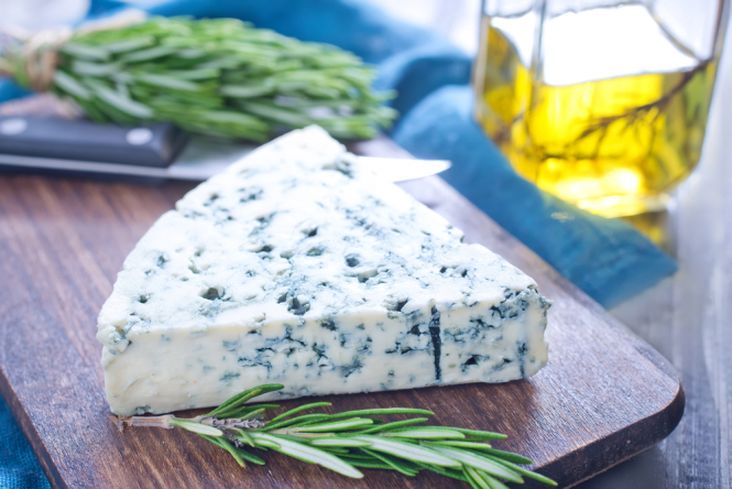 Roquefort cheese on a cheeseboard. French roquefort cheese producers fight low nutrition rating