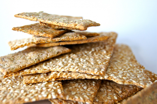 A pile of sesame seed crackers. France recalls sesame seed products due to toxic pesticide