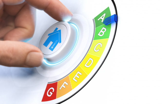 A hand turning a dial on an energy rating, A to G