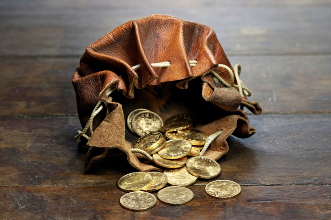 Golden coins pouring out of a leather pouch