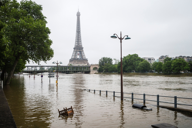 An image of the Seine after a flood, with the Eiffel Tower in the background