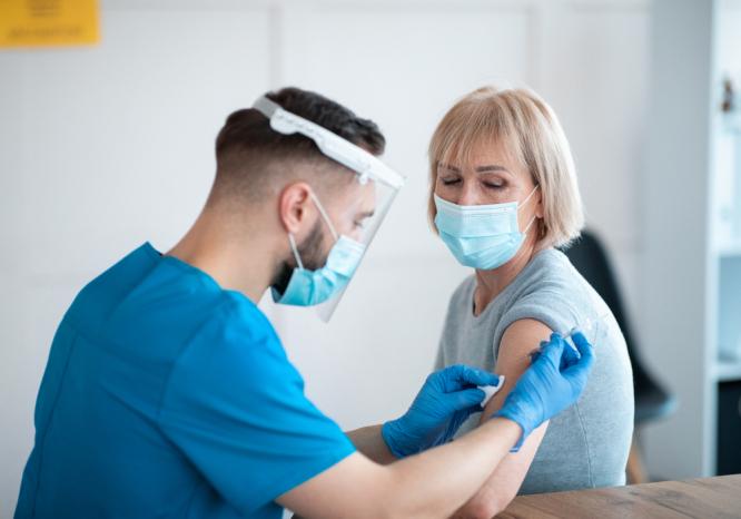 A patient receiving a Covid-19 vaccine