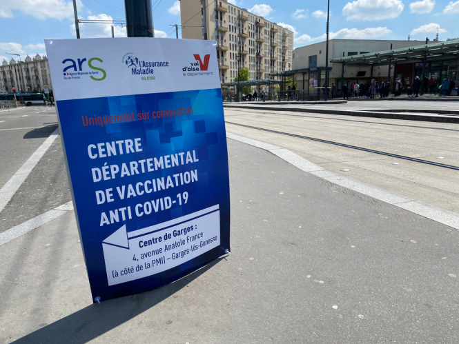 Sign in French directs people to the Covid-19 vaccination centre, Sarcelles, Paris, France. French vaccination campaign could miss '20-30%' of population