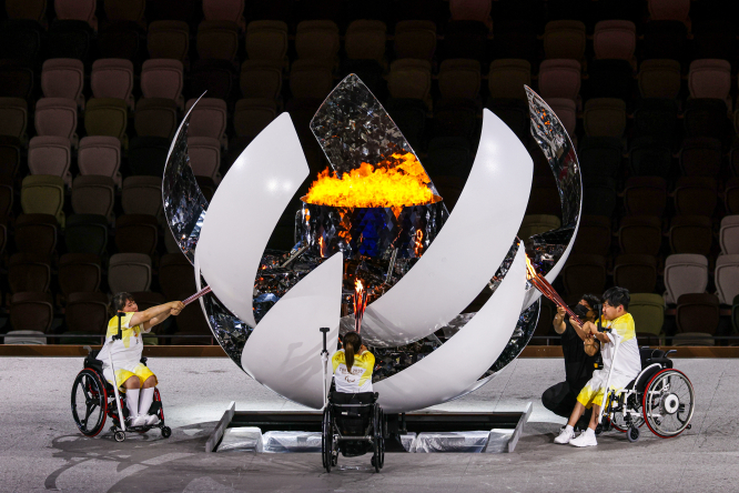 Opening ceremony of the Paralympic Games Tokyo 2020. Three wheelchair users light the paralympic torch