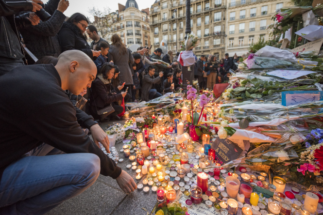 A man pays tribute to victims of the Bataclan attack in Paris on November 13, 2015
