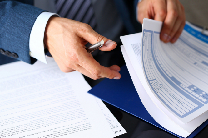 An accountant with insurance forms
