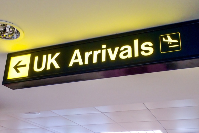 UK arrival's sign at an airport