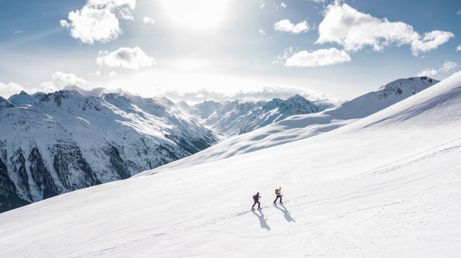 Hikers on a snowy mountain. Thousands sign petition for French ski stations at Christmas