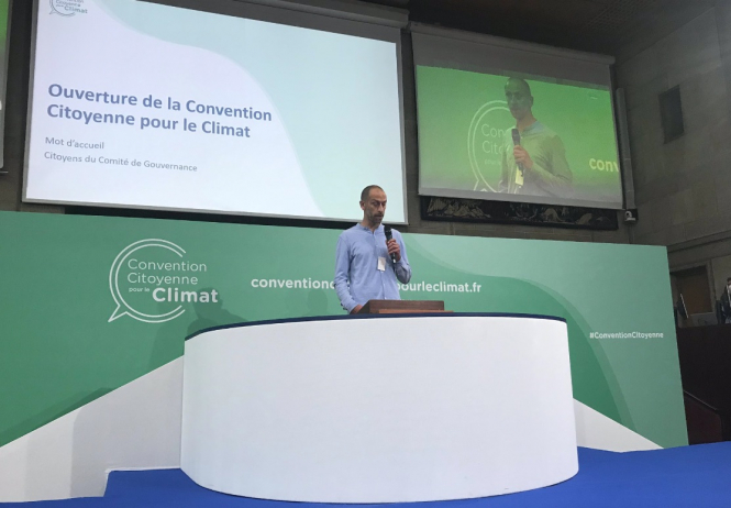 A man speaks at the climate change Convention. The final French climate change Convention is to vote this weekend.