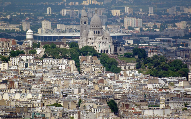 The Stade de France seen behind the Sacre Coeur in Paris. Covid France: How the new mass vaccination centres will work
