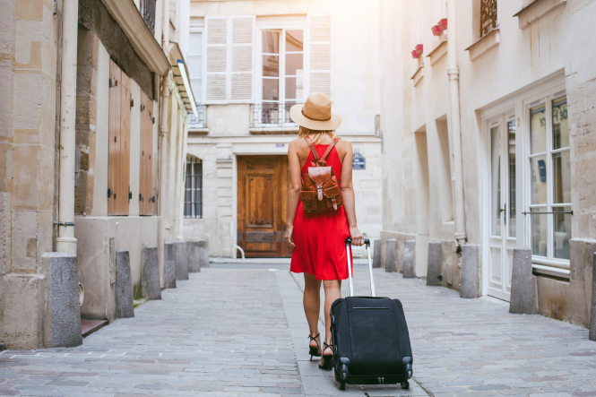 Woman walking with a suitcase
