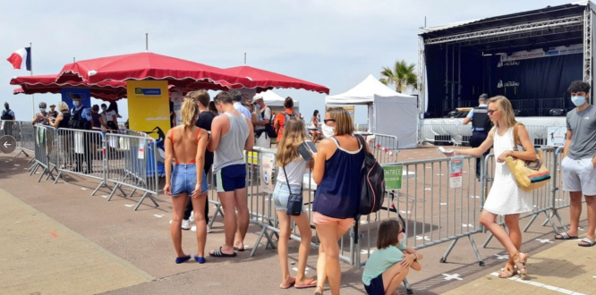 People queue at a temporary summer testing centre. Tourist areas in France open Covid test sites as cases rise