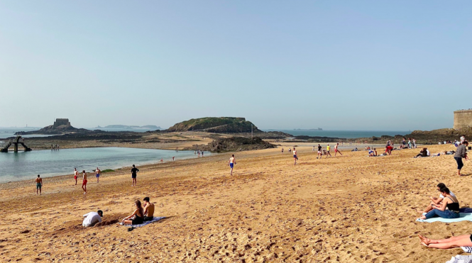 Sunbathers in Saint-Malo. Hot weather records for France but 20C drop and even snow next week
