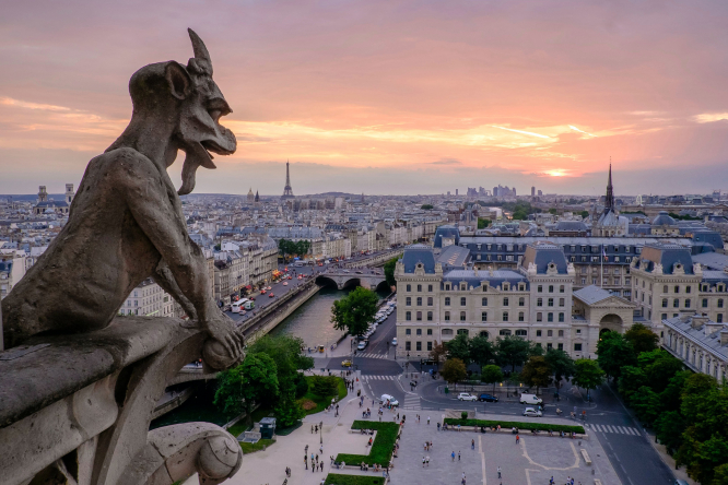 The sun sets over Cathédrale Notre-Dame de Paris, France.
