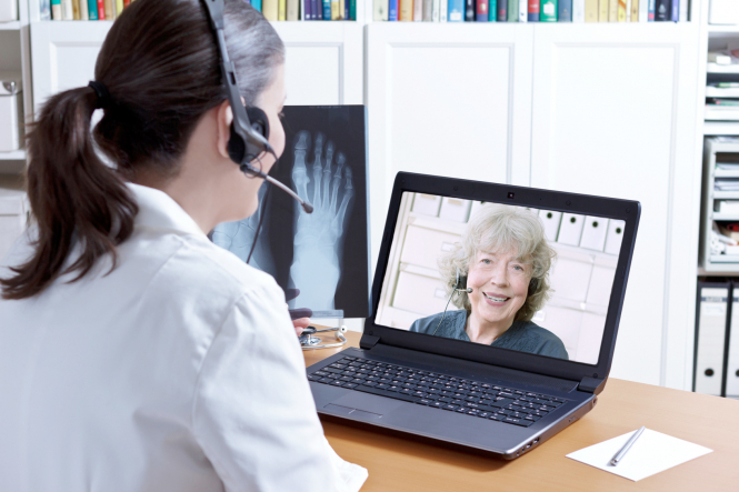 A doctor speaks to a patient on an online call. French public warned: 'Do not delay GP help due to Covid'