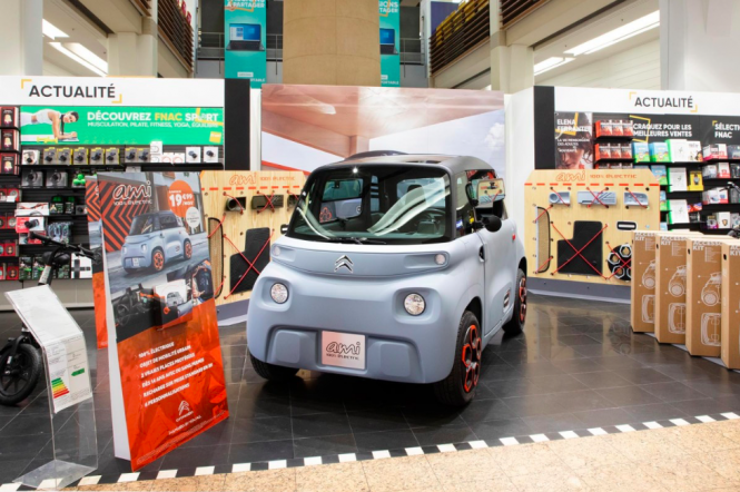 The Citroën AMI, an electric car, on display in a Fnac store. The vehicles are now available to buy from Fnac and Darty in France.