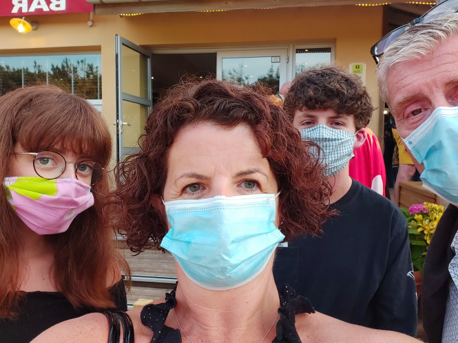 The family who tried a post-lockdown beach holiday with masks on.