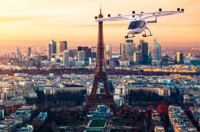 An impression of the VoloCity flying taxi might look like flying by the Eiffel Tower. Plans revealed for flying taxis in Paris 'by 2030'