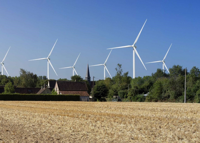 Wind turbines in a field in France. Article: Locals fight to save rural land that Proust loved. Photomontage éoliennes autour de Méréglise. Source Sites & Monuments