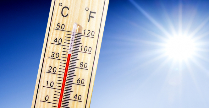 Thermometre rising high in sun. Wildfire risk and heatwave alerts as temperatures hit 37C in France