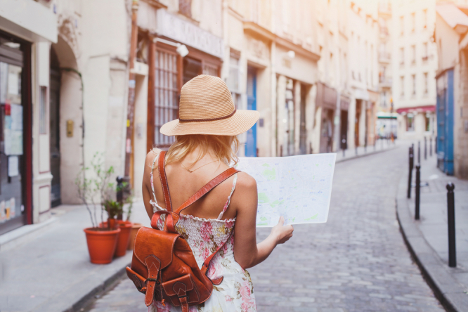 Woman tourist with map on the street. 'Summer bringing hope': France to see 50m foreign visitors this season