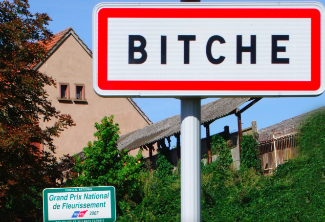 Town name sign in Bitche. French town name Bitche censored on Facebook