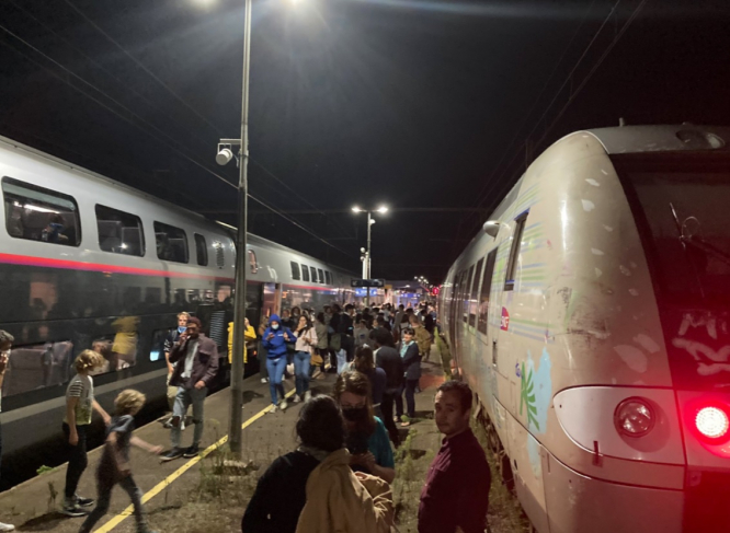 Passengers near delayed TGV trains near Bordeaux last night. SNCF staff announce strike across France amid 20-hour delays