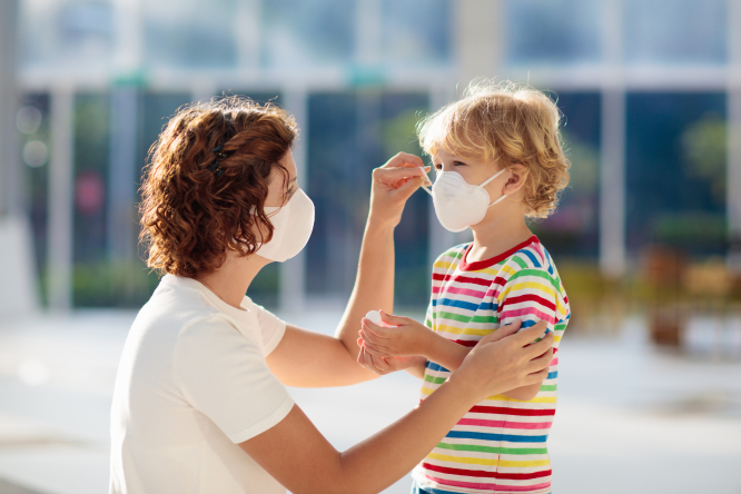 A parent and child wearing facemasks