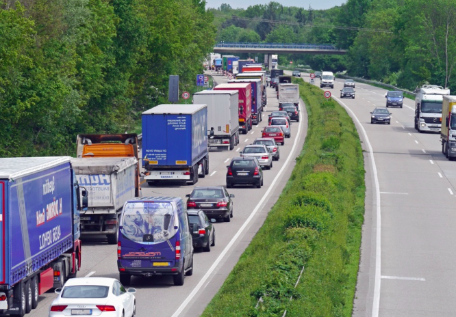 Trucks in a traffic jam. Brexit: Exceptional stockpiling causes delays at Calais border