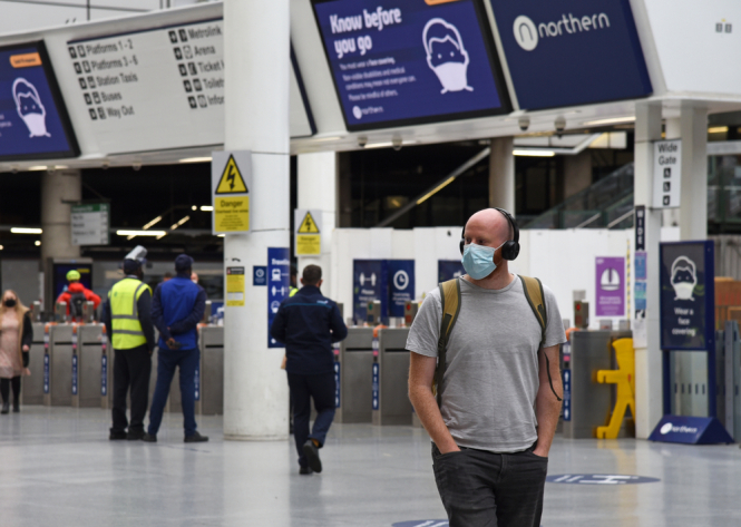 UK airport passenger with mask