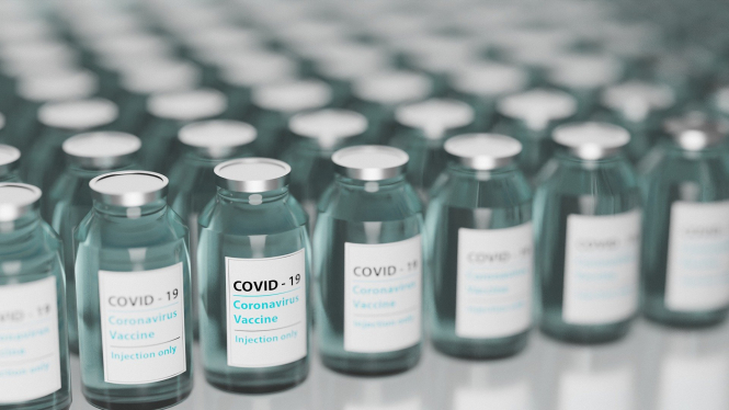 Bottles of the Covid vaccine. France to produce vaccines at four sites 'by February-March' says President Macron