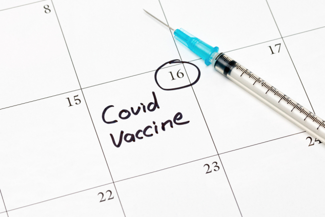 Covid-19 coronavirus vaccine reminder on calendar with syringe and needle. France allows shorter gap between first and second Covid jabs