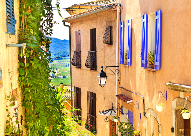 View to countryside through buildings in village in Var. Var knock Paris off top spot for summer Airbnb rentals