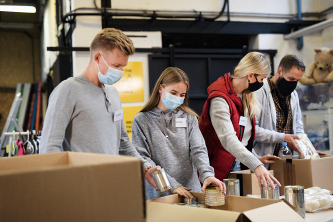 An image of volunteers sorting out food parcels