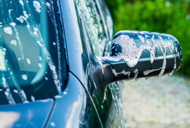 An image of a car wingmirror being washed