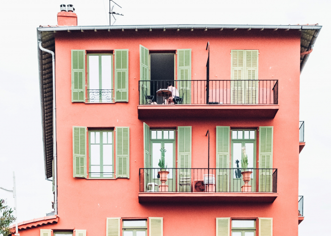 We explain the two free websites to use to calculate your property value online. Pictured: a pink house in Nice, France.