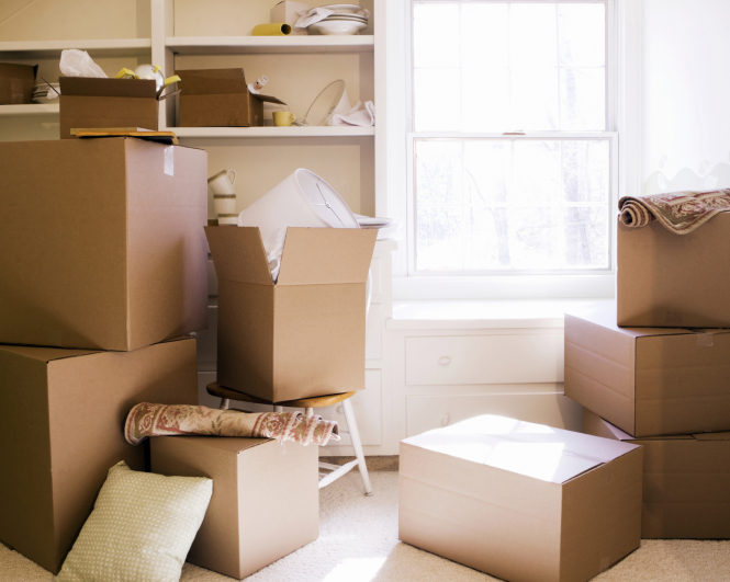 Several cardboard boxes in a room ready to be unpacked during a house move