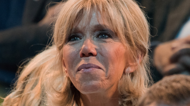 Close-up of Brigitte Macron looking into the distance
