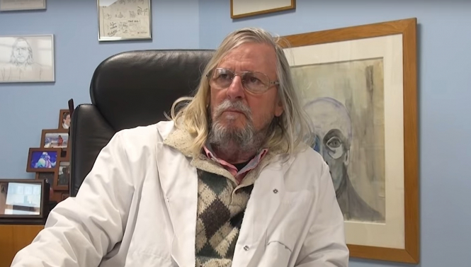 Professor Didier Raoult sitting down wearing a white coat. Controversial French chloroquine Professor Didier Raoult claims: 'I could have halved Covid death'