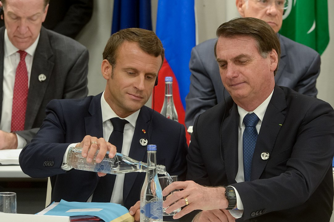 President Macron and President Bolsanaro at a meeting in Osaka, Japan. 'Idiotic': Brazil hits back at President Macron soya comment