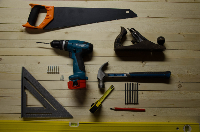 DIY tools on a table. Article: What happens if we sell our self-renovated home in France and faults are found? Photo by Eugen Str / Unsplash