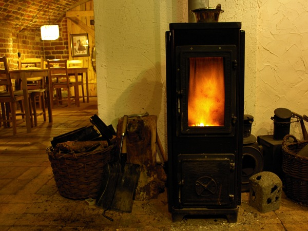 A wood-burning stove in a kitchen. New laws and changes in France for October 2020