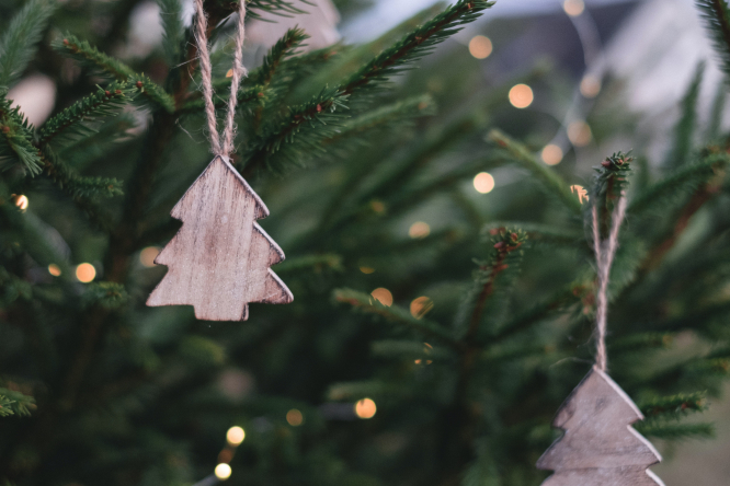 Branches of a Christmas tree with wooden decorations. The mayor of Bordeaux has canceled Christmas trees in the city for 2020.