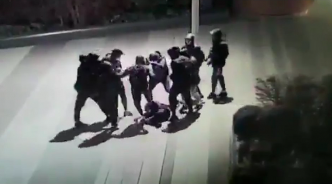 A still from security footage showing Yuriy on the ground, surrounded by his attackers. Violent attack on teenager in Paris shocks France