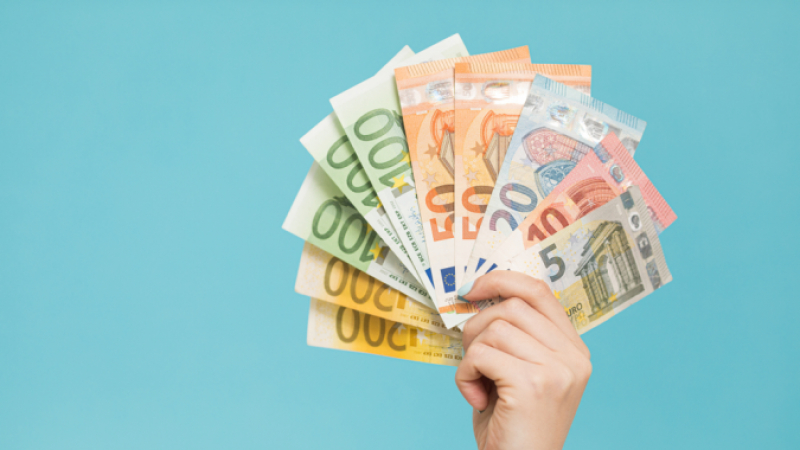 Female hand holding up euros French expressions about money